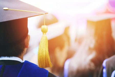 higher education image of student graduating